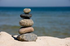 Pebbles stacked on beach Stock Images