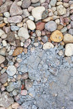 Pebbles stained with cement. Stock Images