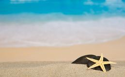 Pebbles and starfish on sand Royalty Free Stock Photo