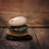 Pebbles stock on wooden background Royalty Free Stock Photography