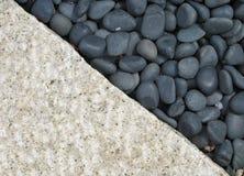 Pebbles and stone. Meet at a diagonal line Royalty Free Stock Photos