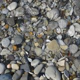 Pebbles and stone in the sea water Stock Images