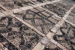 Pebbles stone square road texture Royalty Free Stock Photos
