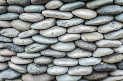 Pebbles stone wall ,texture background Royalty Free Stock Photo