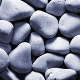 Pebbles stones. As a background. Moonlight effect Royalty Free Stock Image