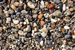 Pebbles, stones on beach. Stock Photo