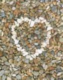 Pebbles stones heart (close-up) Royalty Free Stock Photos