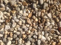 Pebbles, stones, tinyrocks, washed polished pebbles. Tiny white washed polished pebbles Stock Photo