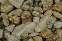 Pebbles, stones. In various shapes and colors, background royalty free stock image