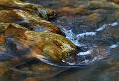Pebbles in a stream Stock Photos