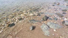 Pebbles on the sunny beach stock video footage