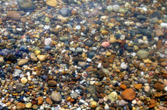 Pebbles texture. Small pebbles in the Danube river, Vienna Stock Photos
