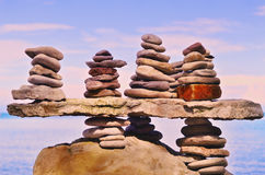 Pebbles on a top of boulder Stock Images