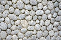 Pebbles wall royalty free stock photos