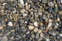 Pebbles and water background Stock Photography