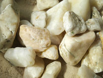 Pebbles. White small pebbles from a mountain lake royalty free stock photography