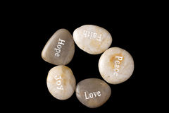 5 Pebbles with words Stock Images