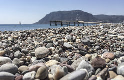 A pebbly beach in Greece Royalty Free Stock Images