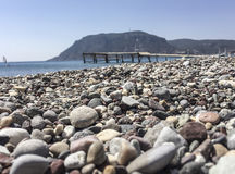 A pebbly beach in Greece Royalty Free Stock Photo