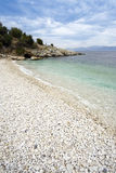 Pebbly beach at Kassiopi, Corfu, Greece Stock Photo