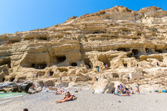 Pebbly beach Matala, Greece Crete. Matala has become famous for artificial  Neolithic caves, carved in limestone rocks. Stock Image