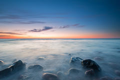 The pebbly beach in Poland at sunset. Long exposure Royalty Free Stock Images