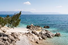 Pebbly Beach in Rabac, Istria region , Croatia. White stone beach at the Adriatic see in Rabac, Istria region , Croatia royalty free stock image