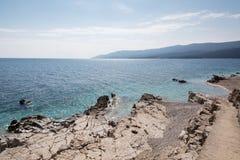 Pebbly Beach in Rabac, Istria region , Croatia. White stone beach at the Adriatic see in Rabac, Istria region , Croatia stock photography