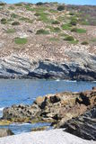 Pebbly beach and seaside cliffs Stock Image