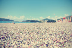 Pebbly beach on a sunny summer day, retro/vintage Royalty Free Stock Images