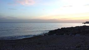 Pebbly beach. Sunset over the pebbly English coast stock image