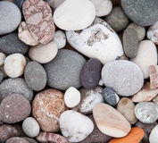 Pebbly seashore background Royalty Free Stock Photo