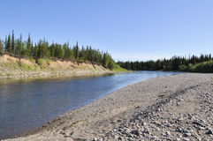 Pebbly shore of the river Kokpela. Stock Photography