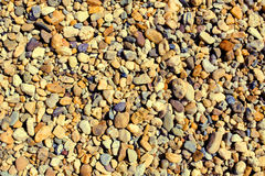 Pebbly surface. Surface with different size gravel - clorful stones Stock Images