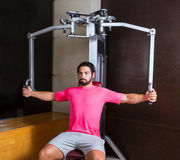 Pec-deck flye pec deck chest workout man Stock Photos