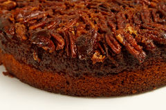 Pecan cake with fresh pecans. A close up on a rich dark Pecan cake with fresh pecans on the top Stock Image