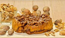 Pecan cake with nuts. Frash bake pecan cake with hold nuts shot on a wood grain back ground Royalty Free Stock Image