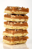 Pecan caramel shortbread cakes. Stacked high Royalty Free Stock Images