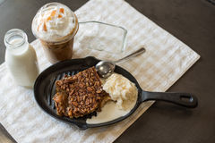 Pecan cobbler alamode with iced coffee Stock Image