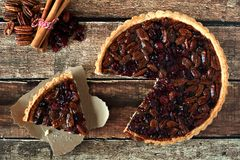 Pecan Cranberry Pie, Overhead Rustic Table Scene With Cut Slice Royalty Free Stock Photos
