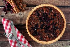 Pecan cranberry pie overhead table scene on rustic wood Stock Image