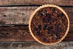 Pecan and cranberry pie on rustic wood background Stock Image