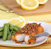 Pecan Fish Fillet. Pecan baked fish fillet with snap peas and lemon slices Royalty Free Stock Images