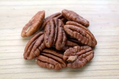 Pecan halves. A group of pecan halves on wooden flat Royalty Free Stock Photos