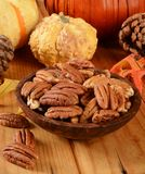 Pecan halves. A wooden bowl of organic pecan halves on a holiday table Royalty Free Stock Photo