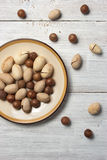Pecan and macadamia nuts on the white background Stock Images