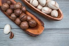 Pecan and macadamia nuts on wooden background. Copy space royalty free stock photography