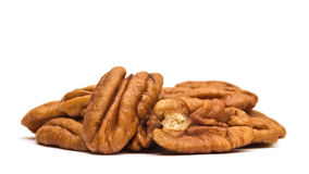 Pecan Nuts. Pile on white background Royalty Free Stock Images