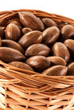 Pecan nuts in a basket. A close up of unshelled pecan nuts in a wicker basket royalty free stock image