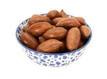 Pecan nuts in a blue and white china bowl Stock Image